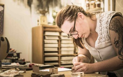 Lotte saws the wooden stamp