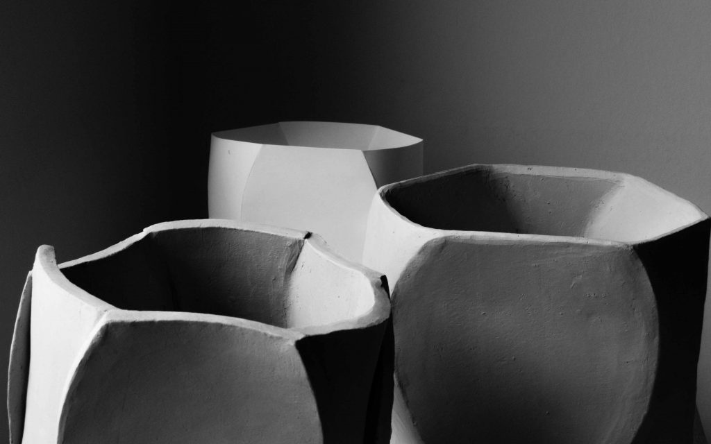 Ceramics vases named Cavex in a corner